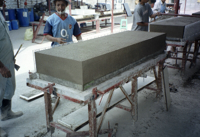 Cutting large foamed concrete block into small blocks