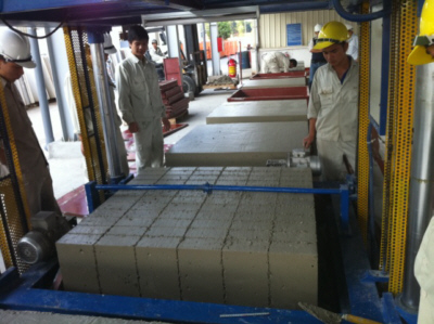 Cutting large foamed concrete block