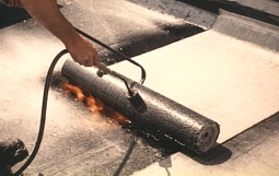 Application of torching membrane onto a roof.