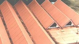 A factory roof with SBS Torching Membrane Superior Grade in a red mineral finish.