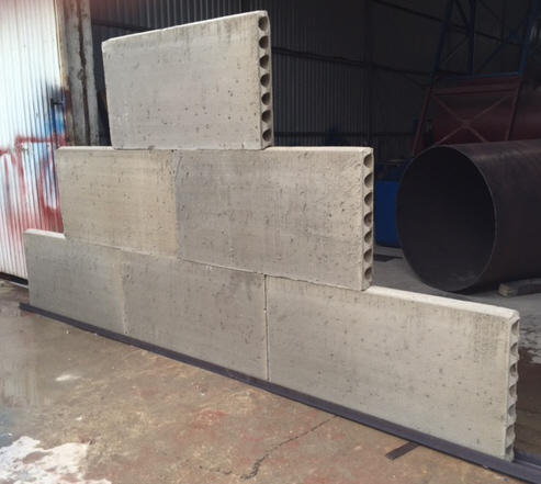 Foamed concrete hollow core panels for building walls for Concrete foam walls